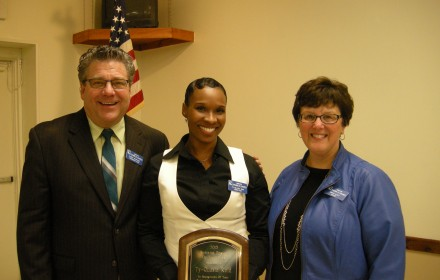 Barry Howard, president and CEO Webster chamber, Tyquasia Earth-Reid, and Virginia Nacy, chair of the chamber board of directors