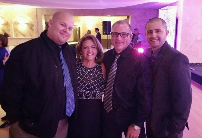 Rose Mary Villarrubia-Izzo pictured here with her family.  From left to right, Carlos Santiago(son), Rose Mary, Dan Izzo (husband),  and Robert Santiago (son).