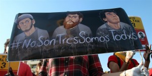 "A student holds a placard during a protest to demand the safe return of three film students who went missing in Guadalajara, Mexico. The placard reads, ""It's not three, it's all of us."" Photo: NBC News"