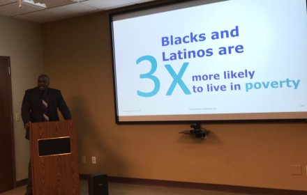 Leonard Brock, executive director of the Rochester-Monroe Anti-Poverty Initiative, talks Nov. 18 about the toll of poverty on health. Photo by Patti Singer/Minority Reporter Media Group.