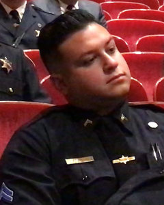 Brandon Bermudez watches as other members of the Monroe County Sheriff's Office are acknowledged for their promotions. Bermudez was promoted to jail corporal. Photo by Patti Singer/Minority Reporter Media Group