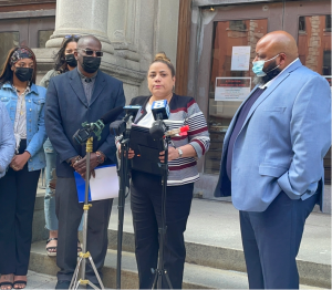Candidates of the Working Families Party urge passage of ethics reform in Monroe County. Standing with WFP is LaKaya Sinclair (far left) and candidates (left to right); Stevie Vargas, Ricky Frazier, Mercedes Vazquez-Simmons and William Burgess. Photo by Tyronda James/Minority Reporter Media Group.